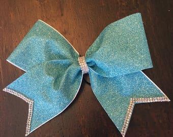 Glitter and rhinestone cheer bow on a hair elastic