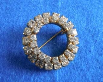 Classic circular sparkling brooch