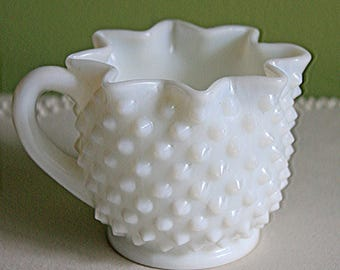 Milk Glass Creamer with Star Shaped Rim and Hobnail Pattern.