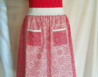 "Red/white lace print ""apron"" skirt. 27"" elastic waistband and contrasting panels/pockets."