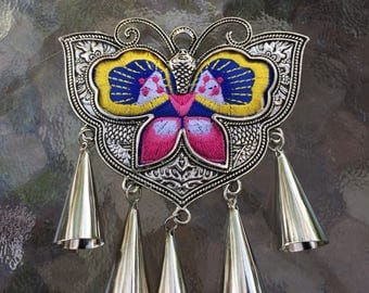 Embroidered butterfly in metal setting pendant with bells hanging down. Traditional Chinese design. Very pretty!