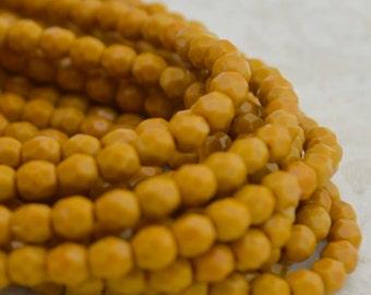 Faceted Round GOLDENROD 4mm Czech Glass Beads Firepolished Qty 50 Opaque Dark Yellow Czech Beads