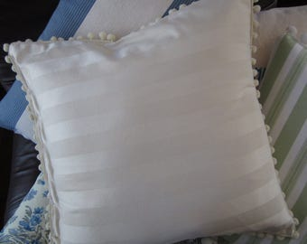 Striped tone on tone off-white/ecru cotton pillow with pompom trim in 3 sizes