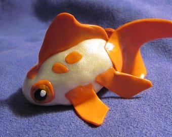 Silver white and orange goldfish sculpture