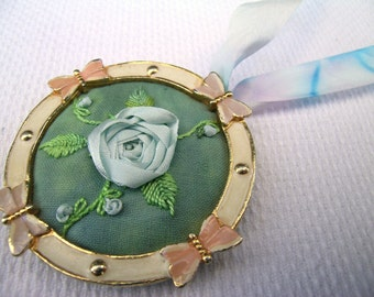 Blue Rose: hand crafted upcycled mixed media embroidered vintage ribbon rose pendant with hand dyed ribbon