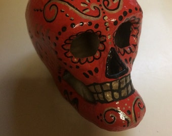 Hand-painted paper mâché sugar skull in red