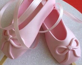 Custom Edible pink ballet slippers ballerina shoes with sticks gum paste fondant cake topper.
