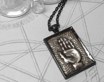 Eye and Hand : hand embossed repoussé metal pendant necklace