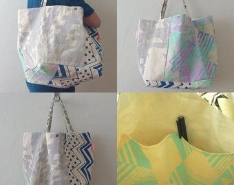 A screen-printed canvas tote bag, Hand printed, Durable canvas, 2 Pockets inside,Button closure, Original designs,