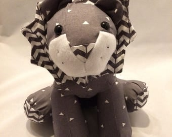 Grey and white arrow/broken chevron stuffed lion plush