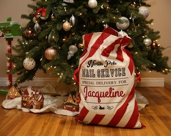 Personalized Santa Sacks. Candy Cane Stripe. North Pole Mail. Christmas Gift Sacks. Great Price. Professional Pressing. After Christmas Sale