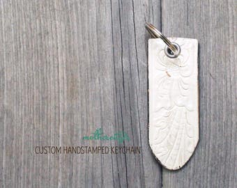 CUSTOM HANDSTAMPED off white distressed leather keychain by mothercuffer