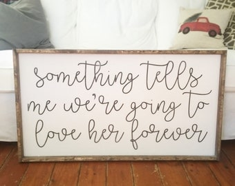 Something tells me we're going to love her forever sign