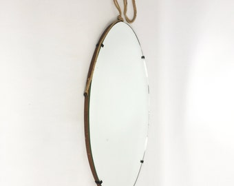 Large oval mirror on a wooden back.