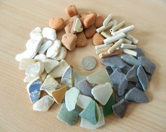Assorted beach finds, sea pottery, sea glass, pipe stems, slate, clay brick and shell for crafts