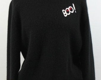 30% Off Sale Black angora blend wool sweater with boo design.
