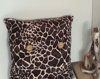 Pillow of soft giraffe-fabric with wooden buttons