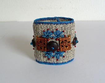 Beautifully crocheted bracelet in gray and blue tones.