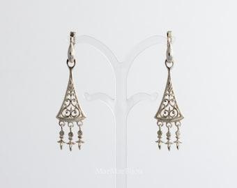 Silver chandelier amulet earrings