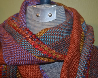 Shades of  rust, lavender , spruce etc hand woven scarf