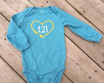 "Down Syndrome Awareness Onesies ~ Baby Girls or Baby Boys, Light Blue Long-Sleeved Onesie with Yellow and White ""T21"" Logo and Arrow Heart"