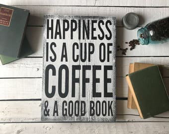 """Happiness is a cup of coffee and a good book 