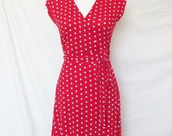 Lucy Spring - Polka dot dress with capped sleeves, tied waistband and surplice v-neck