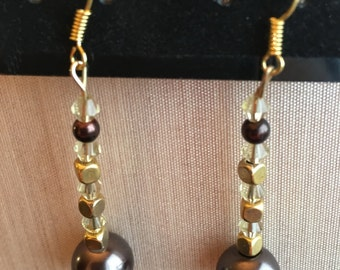 GOEAR_003 Gold colors enhance a dangle earring set. Brown pearl-like beads w square gold colors. Unique handmade, one-of-a-kind earring set.