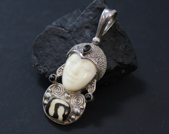 Sterling Silver Designer Signed SAJEN Carved Balinese Goddess Pendant with Bone Face, Mud Bead, and Star Diopside
