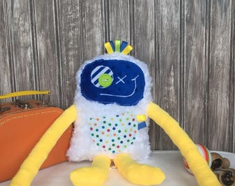 Monster plush with ribbons,yellow and dark blue with dots pocket,baby shower present or birthday gift,unique gift,ready to go.