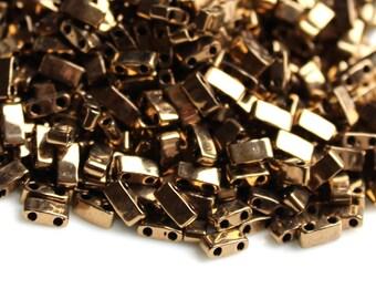 Miyuki Half Tila HTL-0457 Metallic dark bronze. Beads 2.3*5mm. 5 or 10 grams. Bronze half tila. Bronze Miyuki beads. 2 hole bead. flat
