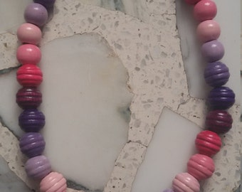 Pink and purple colored wood necklace