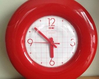 Clock red of the 80s. Plastic vintage, Switzerland