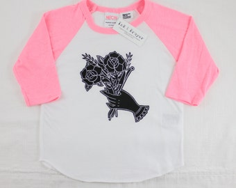 American traditional hands holding flowers pink baseball tee
