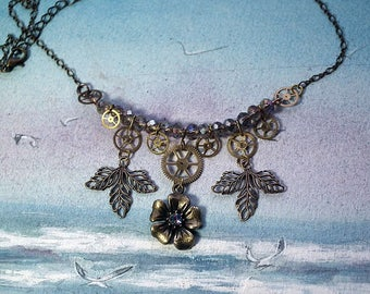 Delicate Steampunk Necklacebronze colour flower and filigree leaves, rainbow swarovski cab, gears, cristal beads  with rainbow fashes