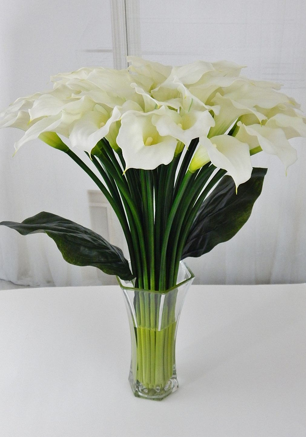Largetall silk modern floral arrangement calla lilylilies largetall silk modern floral arrangement calla lilylilies white faux water acrylicillusion real touch flowers centerpiece glass dhlflorist Images