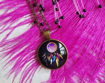 Cabochon pendant necklace featuring colourful dreamcatcher  on a antique brass chain