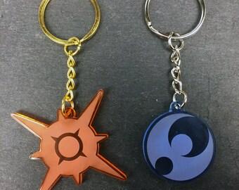 Pokémon Sun & Moon Symbol Keychain (transparent acrylic, laser-cut)