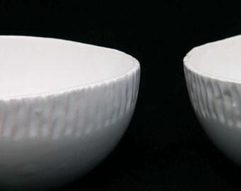 Handmade white ceramic bowl with rustic ribbed edge