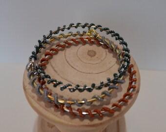 Thread wrapped wire spiral cuff