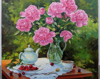 Still life with peonies,tea,cherry,golden tea spoon on a background of greenery.Glass,porcelain,napkin with embroidery richelieu.Pink,green.