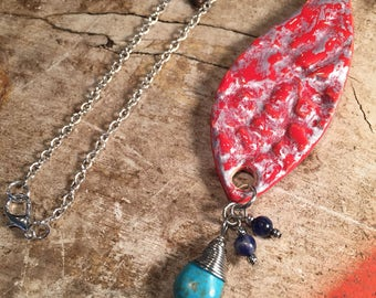 Red and silver ceramic pendant charm necklace on silver chain