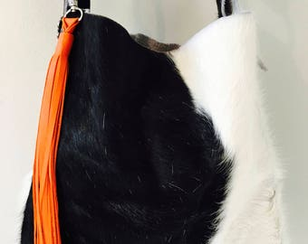 "Hank Henrietta ""The Henry"" style bag, Black and White Hair on Hide, Cowhide Leather with Bright Orange Leather Tassel. Gift for Her"