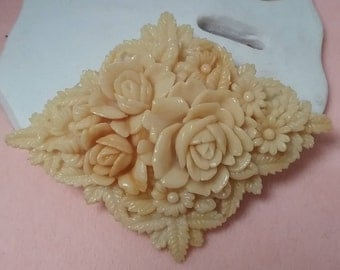 celluloid floral diamond shaped brooch