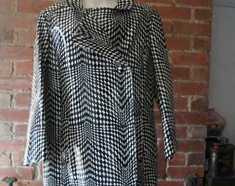 60's vintage mod PVC ladies coat. Saks fifth avenue.