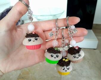Keychains with beads. Kawaii cupcake polymer clay with chocolate icing and decorations. HANDMADE