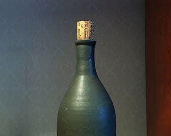 Green ceramic bottle.