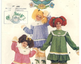 Butterick 6919 Size  M, 6, 8.  Girl's size sewing pattern for Cabbage Patch Kids costume, complete with iron-on decals, dress, bloomers, wig