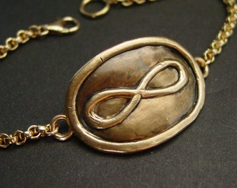 Infinity with gold chain bracelet