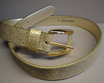 Vintage Donna Katz gold glitter belt, Size Med, 1 and 1/8 inch wide, Fits 27 and 1/2 to 31 and 1/2 inch waist, Made in Taiwan, So sparkly!